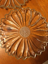 Vintage indiana glass daisy and button plates and vintage hazel atlas sunflower plates. They were made in the 1950s and have been is storage for 30 years. Pickup at the qt on highway 20 or qt on 11th st and 169  Collinsville, 74021