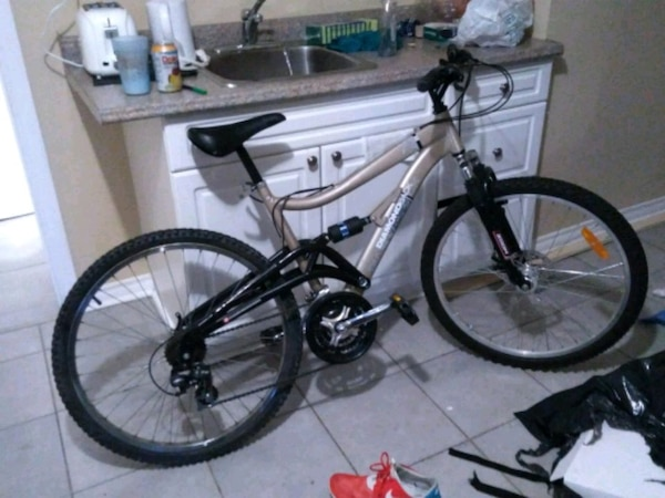 black and white full-suspension mountain bike