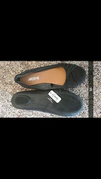 pair of black slip-on shoes Kelowna, V1Y