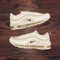 pair of white Nike Air Max shoes LOUISVILLE