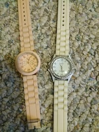 two round gold analog watches with link bracelets