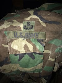 Green, white, and black camouflage textile