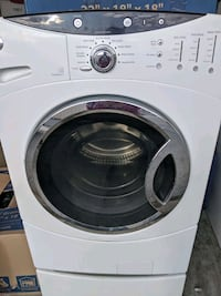 GE Front load washer and dryer with pedestals
