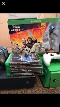 Xbox One console with controller and game cases Kings Mountain, 28086