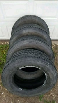 four black rubber car tires Edmonton, T6L 6N3