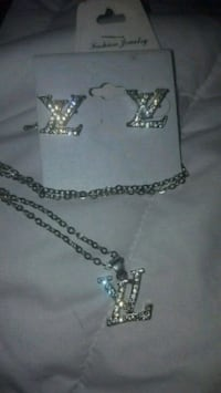 Brand new LV earrings and matching necklace  Winnipeg, R3K 2G6
