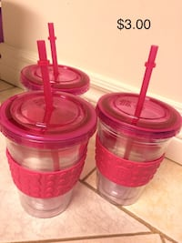 three red and pink plastic containers Toronto, M6J 2X4