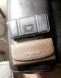 two assorted-color leather wallets Calgary, T3Z 1X5