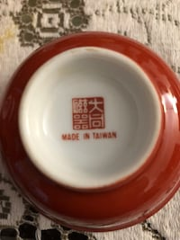 round white and red ceramic plate Vancouver, V6A 3K1