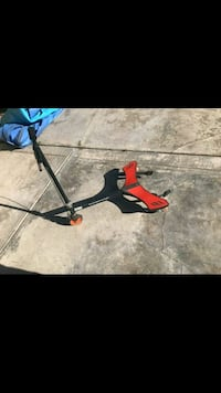 red and black swing scooter