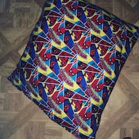 blue, red, and yellow floral textile