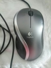 black and gray Logitech corded mouse