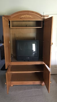 CRT television in brown wood-frame TV hutch Clarksville, 37040