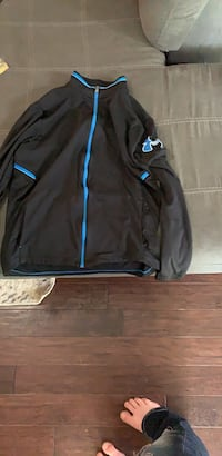 Black and blue under armour zip-up jacket Fort Morgan, 80701