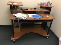 Good quality wood comp desk with wheels Mississauga, L4W