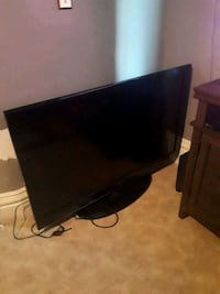 Tv and stand 150.00 firm