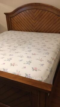 King size bed with frame and mattress.