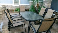 round glass-top patio table with black steel frame Rancho Cucamonga, 91730