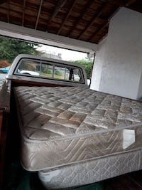 two quilted white and beige mattresses