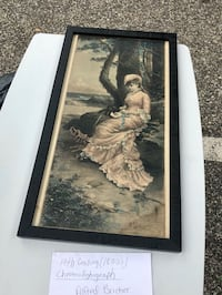 woman in white dress painting with black wooden frame Lindenhurst, 11757