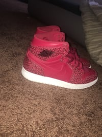 pair of red-and-white Nike Air Force 1 high Lithonia, 30038