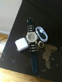 Quartz watch and ring and apple fast charger box a