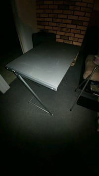 gray Sony PS3 slim console
