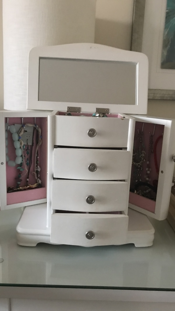 White wooden jewelry armoire