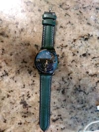 round blue chronograph watch with blue leather strap New York, 10029