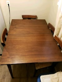 """Solid wood 50""""x36"""" apartment sized table and chairs"""