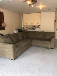 brown suede sectional couch with ottoman null