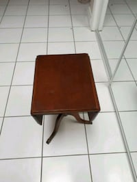 brown wooden antique table with extended flaps