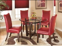 round glass top table with four chairs dining set Brockton, 02301