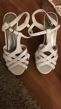 Women's pair of white leather peep toe pumps