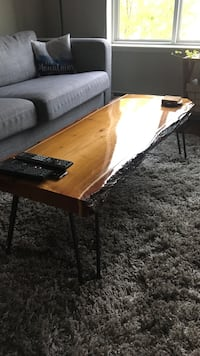 rectangular brown log top center table with two remote Kelowna, V1W