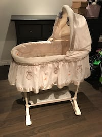 baby's beige and white bassinet