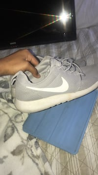 pair of gray Nike running shoes Bakersfield, 93313