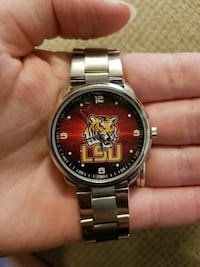 silver and red LSU analog watch