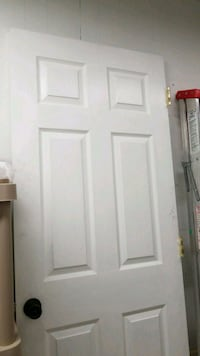 white wooden 6-panel interior door