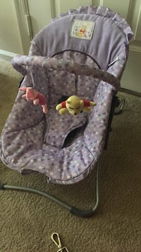 Baby's purple, and white Winnie the Pooh bouncer very clean  Frederick, 21703