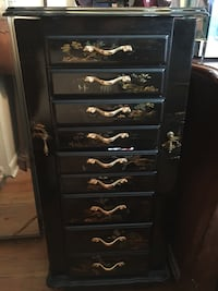 Oriental Jewelry dresser , with 2 side hidden door petty space almost as tall as unit has clips to hang chain etc, and 6 drawers with division in them 3 larger drawers, just an amazing pcs for your jewelry, etc Lodi, 07644