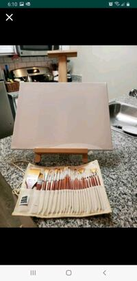 Easel, brushes and canvas