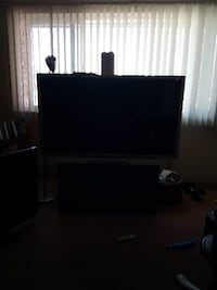 black flat screen TV with black wooden TV stand Covina