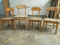four old wooden chairs