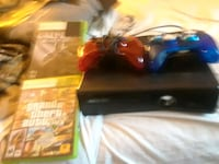 black Xbox 360 console with controller and game cases Nashville, 37013