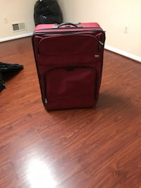 "Red large suitcase 21"" w x 31"" l x 9"" depth Silver Spring, 20902"