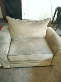 brown fabric sofa chair with throw pillow 48 km