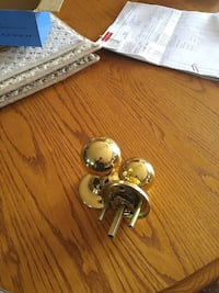 two brass door knobs.   I have about 37 of them.