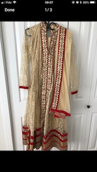 Women's gold and red long sleeve dress. Not worn. 3 pieces. 3748 km