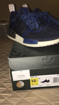 pair of black-blue-and-white Adidas NMD R1 with box